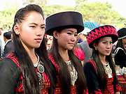 Hmong Der (White Hmong) women wearing contemporary Hmong traditional costumes at Ban Km 52 Hmong New Year festival, Vientiane province, Lao PDR. The Hmong celebration of New Year is based on the lunar calendar. This important time is an opportunity to honour ancestors and spirits through offerings and rituals and to partake in games, sports, feasts, shows, bullfights and courtship. The Hmong are the third largest ethnic group in Laos. One of the most ethnically diverse countries in Southeast Asia, Laos has 49 officially recognised ethnic groups although there are many more self-identified and sub groups. These groups are distinguished by their own customs, beliefs and rituals.