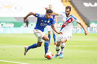 LEICESTER, ENGLAND - JULY 04: James Justin of Leicester City takes the ball past Luka Milivojevic of Crystal Palace during the Premier League match between Leicester City and Crystal Palace at The King Power Stadium on July 4, 2020 in Leicester, United Kingdom. Football Stadiums around Europe remain empty due to the Coronavirus Pandemic as Government social distancing laws prohibit fans inside venues resulting in all fixtures being played behind closed doors. (Photo by MB Media)