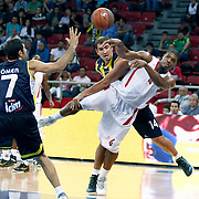 Fenerbahce Ulker's Kaya PEKER (C) and Olimpiakos's Kyle HINES (R) during their Two Nations Cup basketball match Fenerbahce Ulker between Olimpiakos at Abdi Ipekci Arena in Istanbul Turkey on Saturday 01 October 2011. Photo by TURKPIX