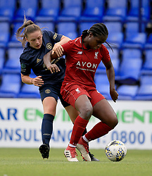 Liverpool Women's Satara Murray (right) and Manchester United Women's Kirsty Hanson battle for the ball during the Continental Tyres Cup, Group Two North match at Prenton Park, Birkenhead.