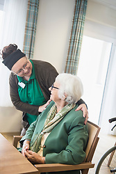 Nursing stuff caring about senior woman in rest home