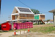 "Make It Right NOLA is Brad Pitt's green project to rebuild the lower 9th ward in New Orleans pictured Dec. 29, 2009 are the rebuilt ""green homes"". The installation of all the pink houses is to represent the 13 different types of green housing offered by Make It Right and they are illuminated at night by solar panels and solar candels."