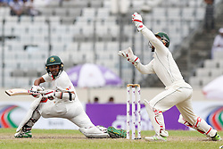 August 29, 2017 - Mirpur, Dhaka, Bangladesh - Bangladesh's Mehedi Hasan Miraz, left, plays a shot, as Australia's wicketkeeper Matthew Wade attempts to catch the ball during the third day of their first test cricket match in Mirpur, Dhaka, Bangladesh. (Credit Image: © Ahmed Salahuddin/NurPhoto via ZUMA Press)