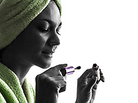 one woman mascara brush in silhouette on white background