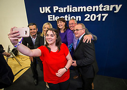 Sinn Fein's Jemma Dollan taking a selfie with (from the left) Pearse Doherty TD, Sinn Fein leader in Northern Ireland Michelle O'Neill, newly elected MP for Fermanagh & South Tyrone Michelle Gildernew, Sean Lynch, and newly elected MP for West Tyrone Barry McElduff at the Omagh Leisure Complex, Co Tyrone.