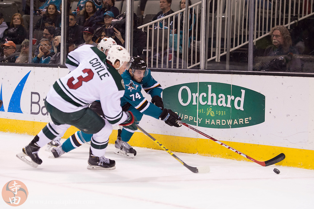 December 12, 2015; San Jose, CA, USA; San Jose Sharks defenseman Dylan DeMelo (74) fights for the puck against Minnesota Wild center Charlie Coyle (3) during the first period at SAP Center at San Jose.
