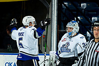 KELOWNA, BC - MARCH 11: Mitch Prowse #5 congratulates Adam Evanoff #31 of the Victoria Royals on the win against the Kelowna Rockets at Prospera Place on March 11, 2020 in Kelowna, Canada. (Photo by Marissa Baecker/Shoot the Breeze)