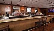 """The long bar at Cunetto's. Photos at Cunetto's House of Pasta """"On The Hill"""" in south St. Louis taken on Wednesday April 21, 2021 for the Better Business Bureau (St. Louis) Torchlight quarterly magazine. <br />Photo byTim Vizer"""