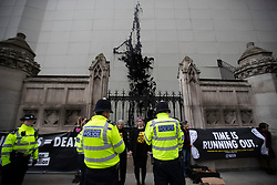 © Licensed to London News Pictures. 26/02/2020. London, UK. Police respond after Extinction Rebellion activists sprayed plant based fake oil on the Hoarding surrounding Big Ben . Photo credit: George Cracknell Wright/LNP