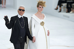 Designer Karl Lagerfeld walks the runway with pregnant model Ashleigh Good for the Chanel collection presentation as part of the Haute-Couture Fall-Winter 2014-2015 fashion week, at the Grand Palais in Paris, France, on July 8, 2014. Photo Thierry Orban/ABACAPRESS.COM