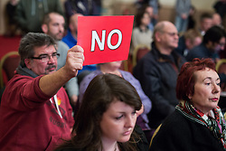 """© Licensed to London News Pictures . 18/11/2014 . Kent , UK . Audience member voting """" NO """" in response to a question at a hustings in the Rochester and Strood by-election , held at the Corn Exchange in Rochester , this evening ( 18th November 2014 ) . Photo credit : Joel Goodman/LNP"""