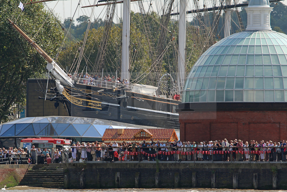 © Licensed to London News Pictures. 09/09/2014. Crowds watch the flotilla from Cutty Sark and Maritime Greenwich. Fifty tall ships have formed a stunning Parade of Sail down the Thames today in a dramatic and thrilling finale to the Royal Greenwich Tall Ships Festival. The ships mustered at Limehouse before moving down the Thames to the delight of onlookers, passing landmarks such as the Old Royal Naval College, the O2 and the Thames Barrier. Credit : Rob Powell/LNP