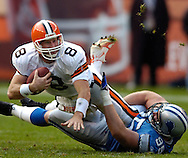 MORNING JOURNAL/DAVID RICHARD.Cleveland quarterback Trent Dilfer is sacked by Jared DeVries yesterday.
