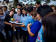 24 JANUARY 2018 - GUINOBATAN, ALBAY, PHILIPPINES: LENI ROBREDO, the Vice President of the Philippines, signs the school visitor book during her visit to Barangay Maninila Evacuation Center in Guinobatan East Central School. The Mayon volcano continued to erupt Tuesday night and Wednesday forcing the Albay provincial government to order more evacuations. By Wednesday evening (Philippine time) more than 60,000 people had been evacuated from communities around the volcano to shelters outside of the 8 kilometer danger zone. Additionally, ash falls continued to disrupt life beyond the danger zones. Several airports in the region, including the airport in Legazpi, the busiest airport in the region, are closed indefinitely because of the amount of ash the volcano has thrown into the air.    PHOTO BY JACK KURTZ