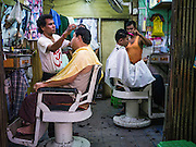 16 JUNE 2013 - YANGON, MYANMAR:  A barbershop in Yangon. Yangon, formerly Rangoon, is the largest city in Myanmar. It is the former capital of the Southeast Asian country. It's still Myanmar's economic capital.      PHOTO BY JACK KURTZ