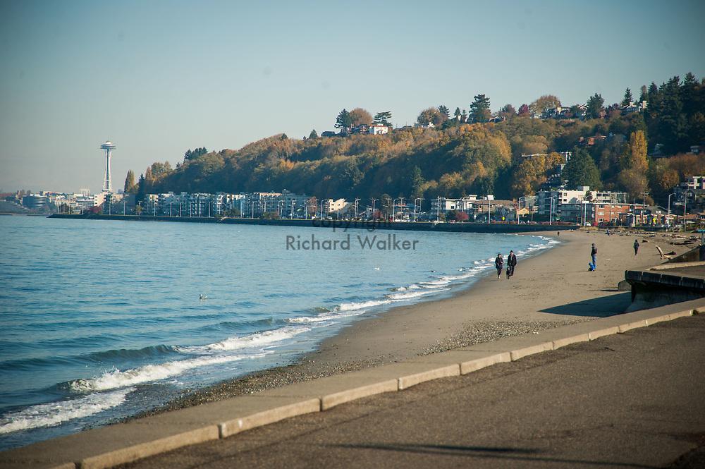 2017 NOVEMBER 06 - People walk along Alki Beach, Seattle, WA, USA. By Richard Walker