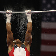 A gymnast cleans chalk dust off the Horizontal bar during the Senior Men Competition at The 2013 P&G Gymnastics Championships, USA Gymnastics' National Championships at the XL, Centre, Hartford, Connecticut, USA. 16th August 2013. Photo Tim Clayton