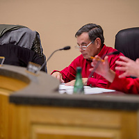 Grants mayor Martin Hicks, left, listens to comments from councilor Cydni Reynolds during a city council meeting Monday in Grants.