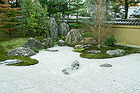 Hoshun-in Zen Garden, Daitokuji Temple, Though not very large, Hoshun-in is an elegantly landscaped garden with oddly overlaying rocks, and attractive for its three dimensional composition.  Hoshun-in offers outstanding seasonal beauty in the flowering season due to lilies and irises surrounding the pond and its Zen rock garden.