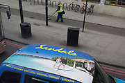 Aerial view of a Sandals Holidays ad on the roof of a London taxi and the reality of passers-by at Elephant & Castle on 23rd April 2018, in London, England.