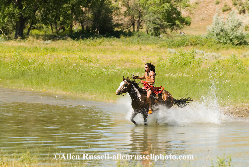 Custers Last Stand Reenactment, Indian gallops across Little Bighorn River, Warriors defeat Custer and 7th Cavalry