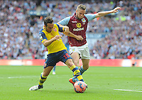 Arsenal's Santi Cazorla vies for possession with Aston Villa Tom Cleverley <br /> <br /> Photographer Ashley Crowden/CameraSport<br /> <br /> Football - The FA Cup Final - Aston Villa v Arsenal - Saturday 30th May 2015 - Wembley - London<br /> <br /> © CameraSport - 43 Linden Ave. Countesthorpe. Leicester. England. LE8 5PG - Tel: +44 (0) 116 277 4147 - admin@camerasport.com - www.camerasport.com