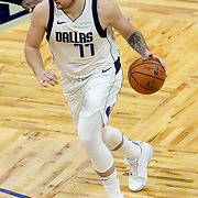 ORLANDO, FL - MARCH 01: Luka Doncic #77 of the Dallas Mavericks controls the ball against the Orlando Magic during the second half at Amway Center on March 1, 2021 in Orlando, Florida. NOTE TO USER: User expressly acknowledges and agrees that, by downloading and or using this photograph, User is consenting to the terms and conditions of the Getty Images License Agreement. (Photo by Alex Menendez/Getty Images)*** Local Caption *** Luka Doncic