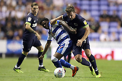 Reading's Omar Richards and Derby County's Craig Bryson (right) battle for the ball during the Sky Bet Championship match at the Madejski Stadium, Reading.