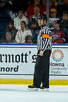 KELOWNA, BC - JANUARY 4: Referee Chris Crich stands on the ice against the Vancouver Giants at Prospera Place on January 4, 2020 in Kelowna, Canada. (Photo by Marissa Baecker/Shoot the Breeze)