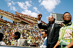 NELSON ROLIHLAHLA MANDELA (July 18, 1918 - December 5, 2013), 95, world renown civil rights activist and world leader. Mandela emerged from prison to become the first black President of South Africa in 1994. As a symbol of peacemaking, he won the 1993 Nobel Peace Prize. Joined his countries anti-apartheid movement in his 20s and then the ANC (African National Congress) in 1942. For next 20 years, he directed a campaign of peaceful, non-violent defiance against the South African government and its racist policies and for his efforts was incarcerated for 27 years. Remained strong and faithful to his cause, thru out his life, of a world of peace. Transforming the world, to make it a better place. PICTURED: 1994 - South Africa - NELSON MANDELA, on the campaign trail.