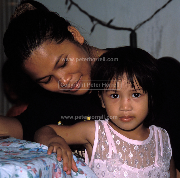 Tabin Wildlife Sanctuary, Sabah. December 24th: Portrait of mother and daughter at Tabin Wildlife Sanctuary.