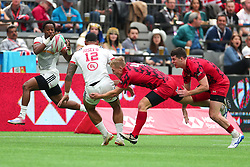 March 9, 2019 - Vancouver, BC, U.S. - VANCOUVER, BC - MARCH 09:  Martin Iosefo (12) of the USA passes the ball to teammate Carlin Isles (1) to during day 1 of the 2019 Canada Sevens Rugby Tournament on March 9, 2019 at BC Place in Vancouver, British Columbia, Canada. (Photo by Devin Manky/Icon Sportswire) (Credit Image: © Devin Manky/Icon SMI via ZUMA Press)