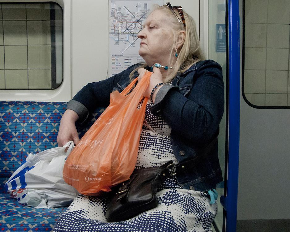 Elderly Lady travelling on the London Underground Network