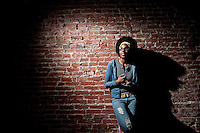 Promotional portrait of musician Syna So Pro