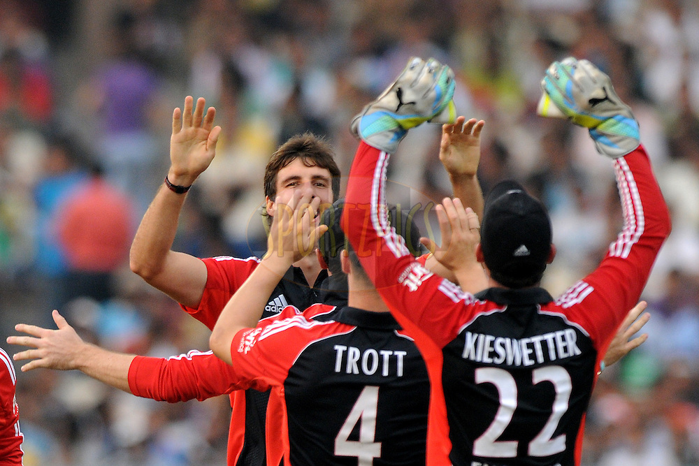 Steven Finn of England celebrates the wicket of Virat Kohli of India during the 5th One Day International ( ODI ) match between India and England held at the Eden Gardens Stadium, Kolkata on the 23rd October 2011..Photo by Pal Pillai/BCCI/SPORTZPICS