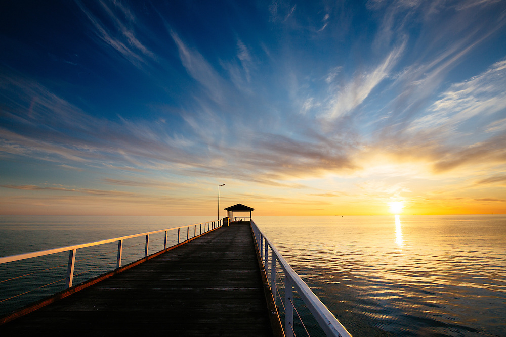 Sunset looking down Grange Jetty into the calm Gulf St Vincent, Adelaide.