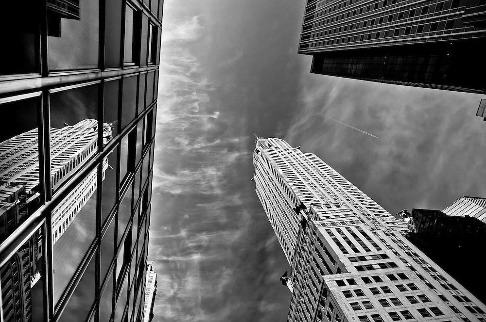 The Chrysler Building and its reflection on the glass window of a building on 42th street, Manhattan, New York, 2010.