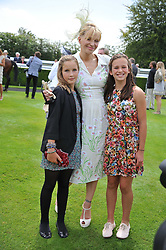 COURTNEY LOVE, LADY ELOISE GORDON-LENNOX and MIA SELMAN at the 3rd day of the 2011 Glorious Goodwood Racing Festival - Ladies Day at Goodwood Racecourse, West Sussex on 28th July 2011.