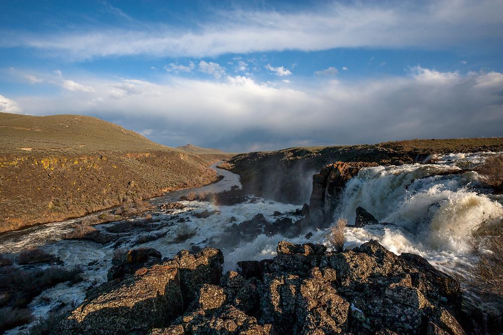 Springtime runoff overflows Magic Reservoir in the Idaho Desert near Shoshone in am ancient volcanic lava geologic area of South Idaho