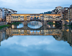 Evening view of historic ponte Vecchio bridge over Arno River in Florence Italy