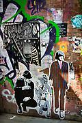 Stencil and graffiti wall art on Whitby Street, London.