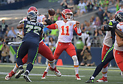 Aug 25, 2017; Seattle, WA, USA; Kansas City Chiefs quarterback Alex Smith (11) throws a pass against the Seattle Seahawks during a NFL football game at CenturyLink Field.