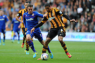 Hull's Curtis Davies ® is challenged by Cardiff's Andrew Taylor. Barclays Premier league match, Hull city v Cardiff city at the KC Stadium in Hull on Sat 14th Sept 2013. pic by Andrew Orchard, Andrew Orchard sports photography,
