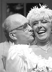 File photo dated 17/08/87 of Coronation Street barmaid Bet Lynch (actress Julie Goodyear) getting a kiss from television groom Alec Gilroy (actor Roy Barraclough). The former Coronation Street actor Roy Barraclough has died today aged 81 after a short illness, his agent said.
