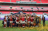 Football - 2020 Emirates 'Heads Up' FA Cup Final - Arsenal vs. Chelsea <br /> <br /> Arsenal captain Pierre-Emerick Aubameyang lifts the trophy as the team celebrates victory, at Wembley Stadium.<br /> <br /> The match is being played behind closed doors because of the current COVID-19 Coronavirus pandemic, and government social distancing/lockdown restrictions.