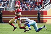 San Francisco 49ers quarterback Blaine Gabbert (2) slips through a Dallas Cowboys tackle at Levis Stadium in Santa Clara, Calif., on October 2, 2016. (Stan Olszewski/Special to S.F. Examiner)