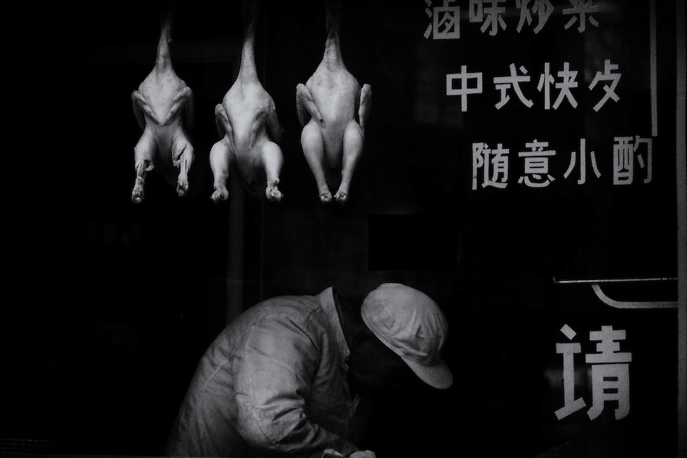 Chinese butcher at work