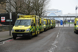 ©Licensed to London News Pictures; 01/01/2021, London UK; Ambulances & training vehicles are lined up at the Nightingale hospital in East London, in anticipation of the venue once again receiving Covid 19 patients : Photo credit, Steve Poston/LNP
