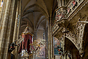 The interior of St Vitas' Cathedral in Prague Castle, on 18th March, 2018, in Prague, the Czech Republic. The Metropolitan Cathedral of Saints Vitus, Wenceslaus and Adalbert is a Roman Catholic metropolitan cathedral in Prague, the seat of the Archbishop of Prague. Until 1997, the cathedral was dedicated only to Saint Vitus, and is still commonly named only as St. Vitus Cathedral. This cathedral is a prominent example of Gothic architecture and is the largest and most important church in the country. It is located within Hradcany-Prazsky Hrad (Prague Castle) in the Czech capital.