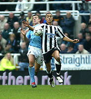 Photo. Andrew Unwin.<br /> Newcastle United v Manchester City, Barclaycard Premier League, St James' Park, Newcastle upon Tyne 22/11/2003.<br /> Newcastle's Jermaine Jenas (r) holds off City's Joey Barton (l)<br /> .